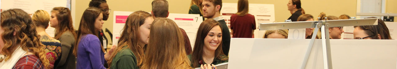 Photo of students in a poster session