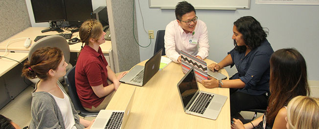 Alex Wong in a lab meeting with students