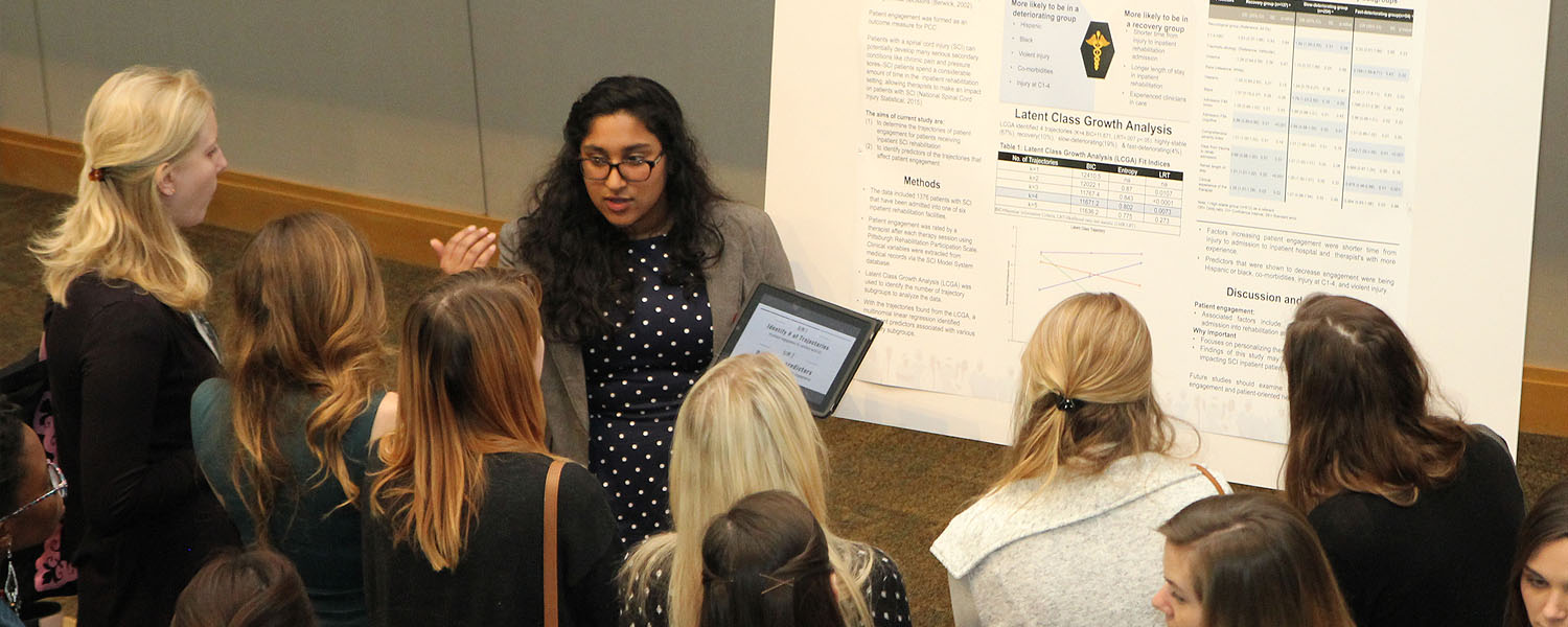 Image of student presenting a research poster