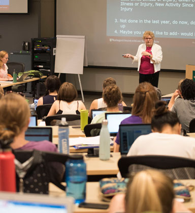 Photo of M. Carolyn Baum teaching